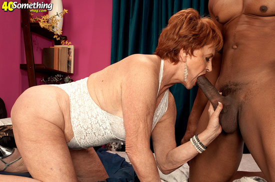 Mature redhead sucking dick